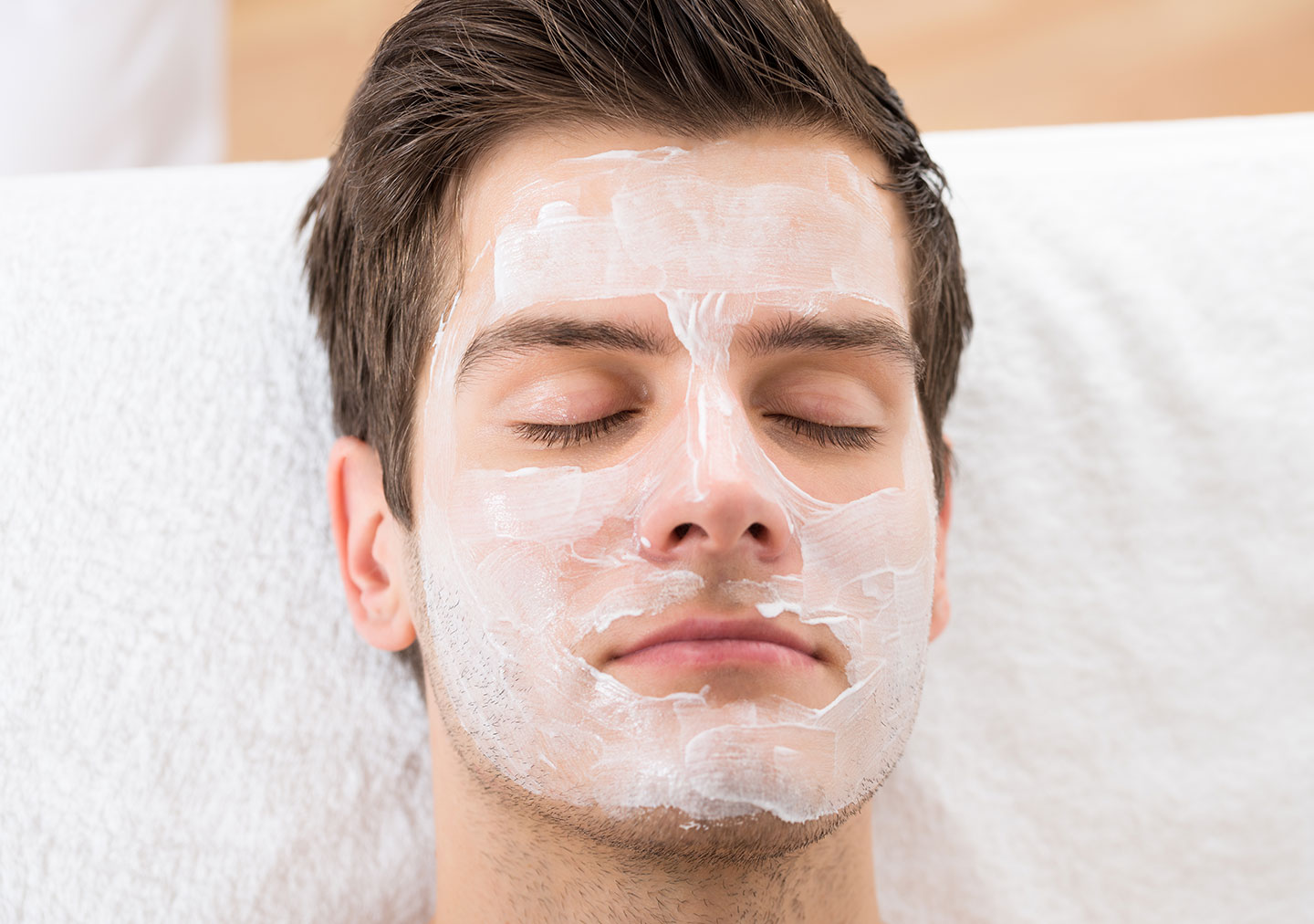 Man in Spa with Facial Mask