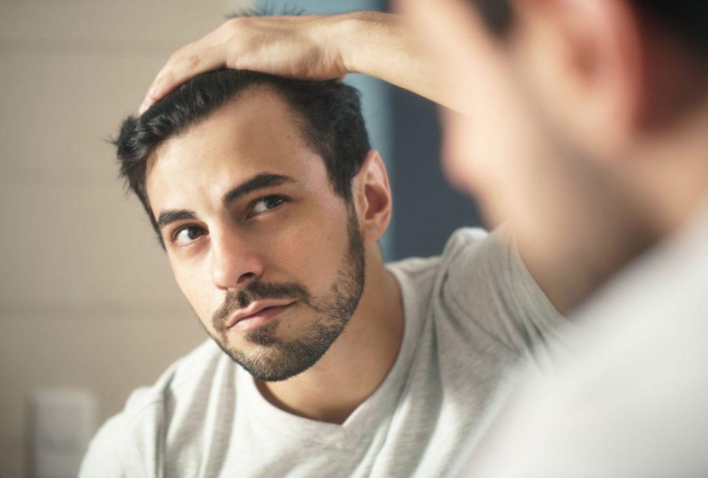 Man Looking Mirror Hair Regrowth